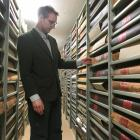 North Otago Museum archive curator Chris Meech inspects volumes of the Oamaru Mail newspaper at...
