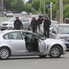 Armed police executed two search warrants in Oamaru yesterday morning. PHOTO: HAMISH MACLEAN