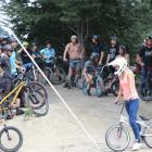 Riders from the Queenstown biking community wait to drop in at the Gorge Road Jump Park yesterday...