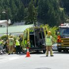 Emergency services at the scene of a crash between a motorbike and car in Queenstown yesterday....