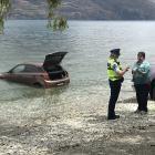 Police, and curious onlookers went to the lakefront across the road from the Rydges Hotel after...