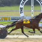 Red Hot Rocket and trainer-driver Gavin Smith win the feature 2600m handicap race at at the...
