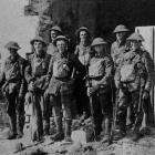 A section of New Zealand riflemen (one of the first through Bapaume) in a ruined house on the...