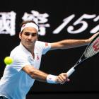 Roger Federer plays a backhand during his second round win at the Australian Open yesterday....