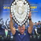 Otago Rugby Football Union community rugby manager Richard Perkins with the restored Ranfurly...