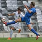 Southern United defender Erik Panzer gets across to clear the ball from Team Wellington's Jack...
