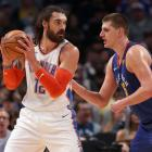 Oklahoma City Thunder centre Steven Adams (left) posts up against Nikola Jokic of the Denver...