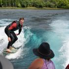 Surfing Lake Wanaka on a special wave created by his family's Malibu jet-boat is Korban...