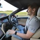 Rockertwerkz founder Dean Hall enjoys a handsfree moment in his Tesla. Photo: ODT files