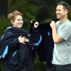 Leo Tucker (13) proudly holds his new King's High School uniform, helped by his father, Gordon....