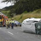 A white Kia people mover lies on its side about 300m south of Waitati  yesterday afternoon....
