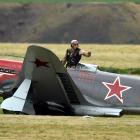 Yak-3 pilot Arthur Dovey signals he is unhurt after the aircraft he was landing collided with a...