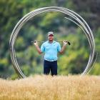 New Zealand No 1 Ryan Fox poses in front of a sculpture on The Hills course in Arrowtown during a...