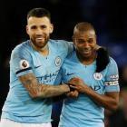Manchester City's Nicolas Otamendi and Fernandinho celebrate their victory. Photo: Reuters