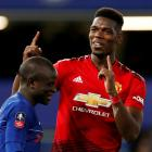 Manchester United's Paul Pogba (R) gestures alongside Chelsea's N'Golo Kante at the end of the...