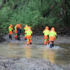 Members of the Fiordland Search and Rescue team  look near the Manuherikia River for Mr Bates in...