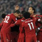 Liverpool's Divock Origi celebrates with teammates after scoring his side's third goal against...