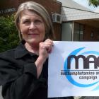 Clutha District Council community support and development adviser Jean Proctor shows off the new...