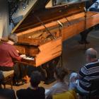 Belgium-based concert pianist Catherine Geels performs at the Alexander Pianos showroom in...