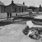 Flood damage at Clyde Terrace, Kaitangata. — Otago Witness, 12.2.1919.