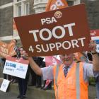 Dunedin District Court staffer Dave Pegg protests along with other court workers, lawyers, and...