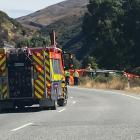 Emergency services at the scene of a serious crash between a car and motorcycle near Cardrona....