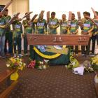 Members of the Green Island Super Chunkz cricket team form a final guard of honour on Saturday at...