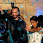 Presidential candidate Nayib Bukele and his wife Gabriela de Bukele celebrate with supporters...