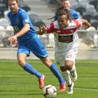 Waitakere United's Andrew Abba on the attack as Southern United defenders Erik Panzer (left) and...