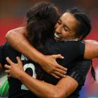 Shakira Baker and Sarah Hirini, of New Zealand, celebrate a try in their pool match against...