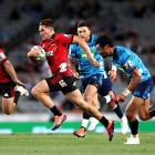 George Bridge of the Crusaders makes a break during the Super Rugby match between the Blues and...