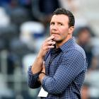 Highlanders coach Aaron Mauger looks on before the start of his side's Super Rugby match against...