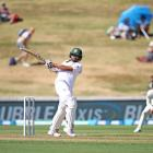 Tamim Iqbal hits out on his way to a half-century for Bangladesh against New Zealand. Photo:...