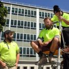 Hayward College contractors Todd Hendry (left) and Nathan Hastie get a cut from the Gib-fixing...