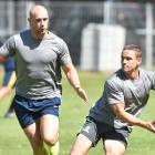 New Otago signing Kayne Hammington (right) looks to move the ball with Matt Faddes in support at...