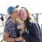 Hannah Morgan cuddles up to her mother, Jane, at the Bluff Ferry Terminal after completing her...