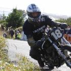 Kevin Ryan, of Greymouth, accelerates his 1966 Triumph MLC 800 up the hill in the Burt Munro...