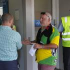 Riverton resident Wayne Hill (centre) speaks to an unknown bank member about the closure of the...