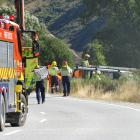 Emergency services work at the scene of a fatal crash on the Crown Range Rd yesterday afternoon....