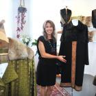 Dunedin designer Jane Avery and the bespoke coats in her lower Stuart St studio. Photo: Christine...