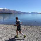 Englishman Keith Burrows tackles the last few kilometres on the shores of Lake Ohau on the second...