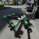 Three Lime scooters lie on the footpath outside Otago Polytechnic yesterday. The Dunedin City...