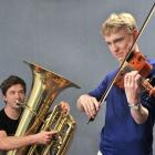 Logan Park High School tuba player Connor Bedwell (16) and violinist Cameron Monteath (17) start...