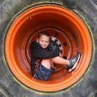 Mosgiel boy Byron Marshall-Sanders (5) curls up inside the wheel of the monster truck at the...