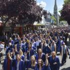 Otago Polytechnic graduands celebrate their success during the graduation march along George St,...