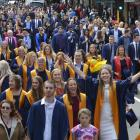 Otago Polytechnic graduands march up George St before last year's graduation. PHOTO GERARD O'BRIEN