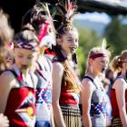 Arrowtown School kapa haka group member Eliana Collins (12) finds a light moment during the...