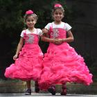Former Syrian refugees Narjes (8) and Ayat (10) Jamal dressed up for a welcoming ceremony for new...