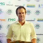 Alan Harvey displays the trophy he received for winning Aorangi FMG Young Farmer of the Year....