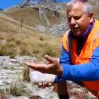 Ross Lawrence uses a dust buster to collect epilobium seeds. Photo: NZSKI Facebook